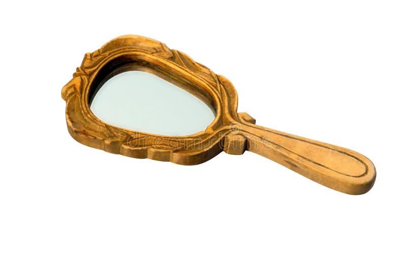 Spegel för gammal hand för tappning i träramen som isoleras på vit royaltyfri fotografi