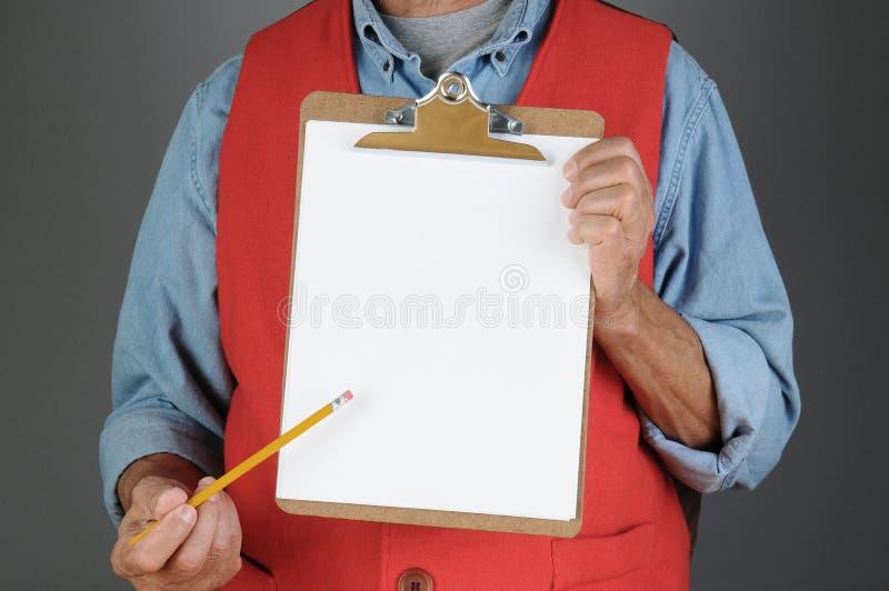 Speichern Sie die Arbeitskraft, die auf Klipp-Brett zeigt lizenzfreie stockbilder
