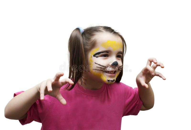 Spela flickan i kattmaskering arkivfoto