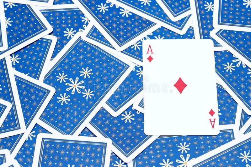 Spela kortöverdängaren av diamanten royaltyfria foton