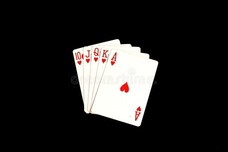 Spela kort - en kunglig spolning i hjärtor royaltyfria foton