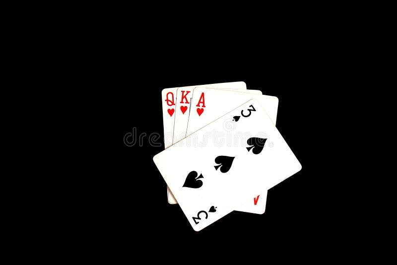 Spela kort - ett spelat trumfkort royaltyfria foton