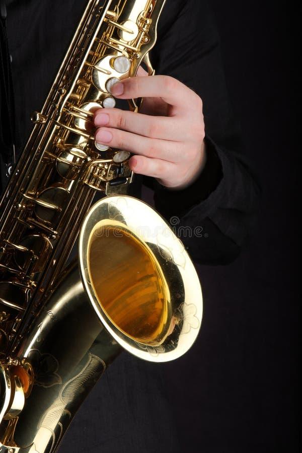 spelaresaxofon royaltyfri bild
