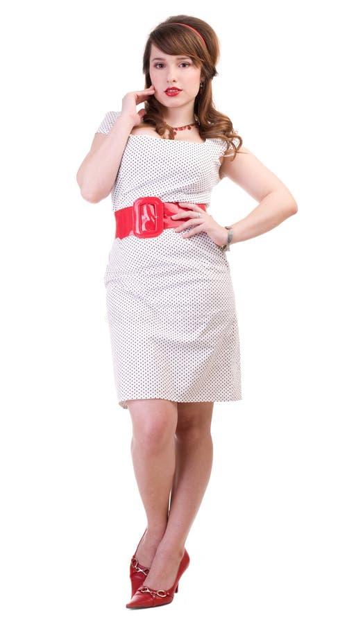 Speld-op meisje in witte polka-punt kleding stock fotografie