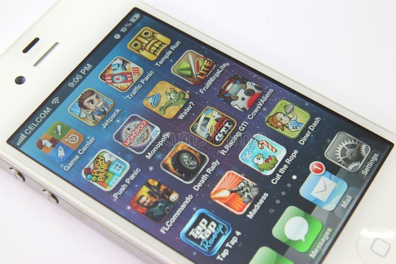 Spelen Apps op iPhone 4S stock foto