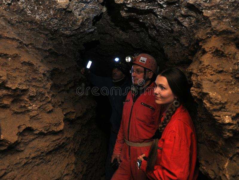 Speleologists and visitors in the gypsum cave. Mlynky - Chortkiv - Ukraine - February 24, 2013. Speleologists and visitors get acquainted in the natural gypsum royalty free stock photos