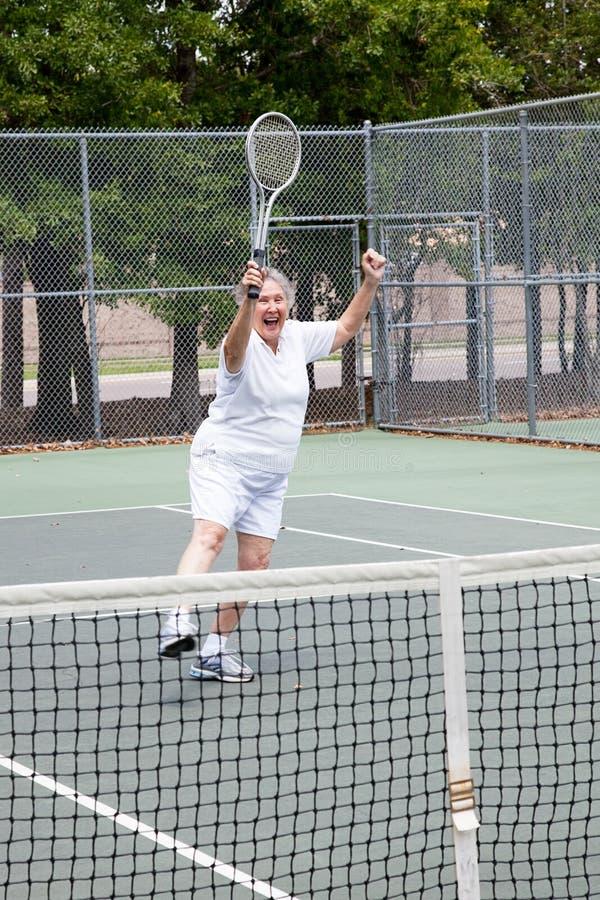 Speler die van het tennis - de wint stock foto