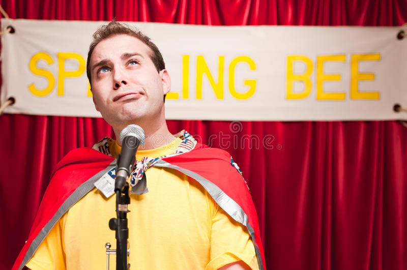 Spelling Bee Contestant. A grown man pretending to be a young boy competeing in a spelling bee royalty free stock images