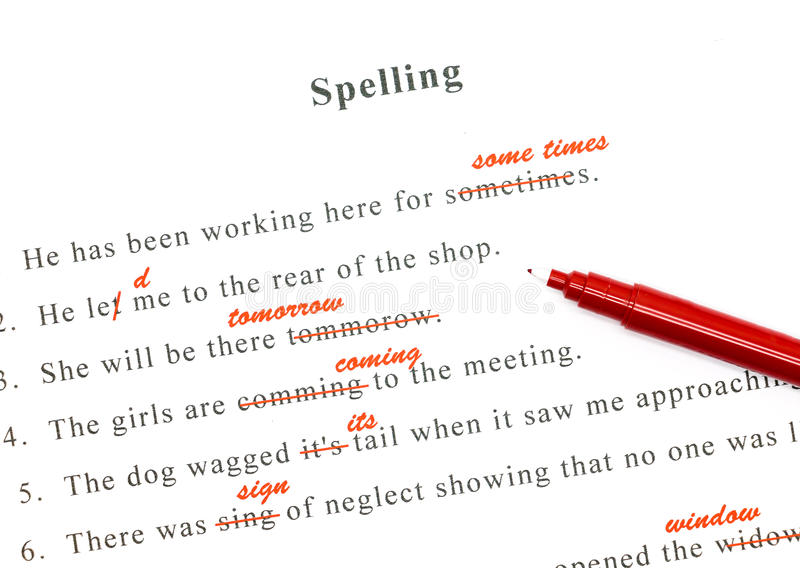 Spelling check on English sentences. Red pen marked on wrong spelling and write correct word above royalty free stock photo