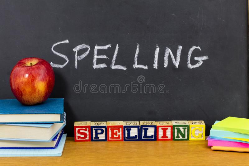 Spelling learning student note pad books school desk royalty free stock images