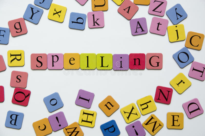 Spelling. Toy magnetic letters spelling the word Spelling stock photography