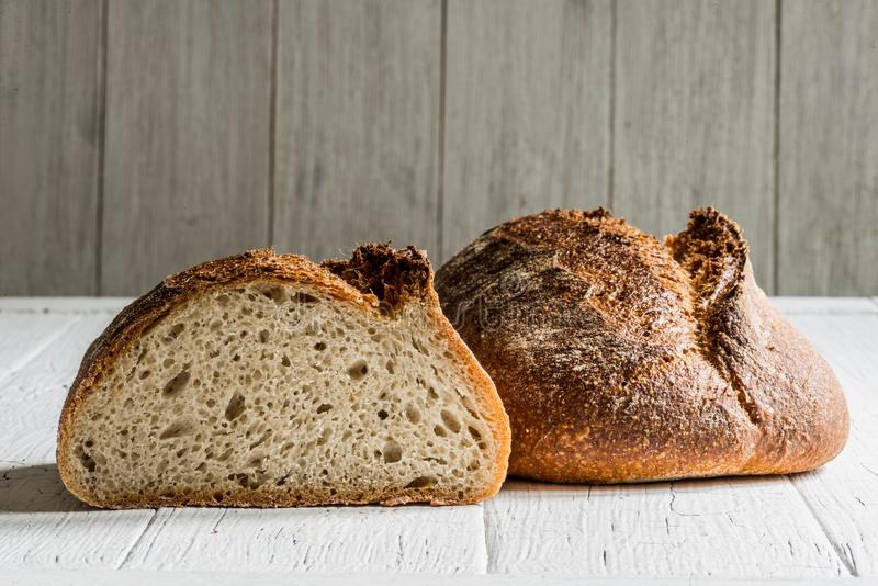 Spelt sourdough bread. Spelt quinoa sourdough bread on a white table board royalty free stock images