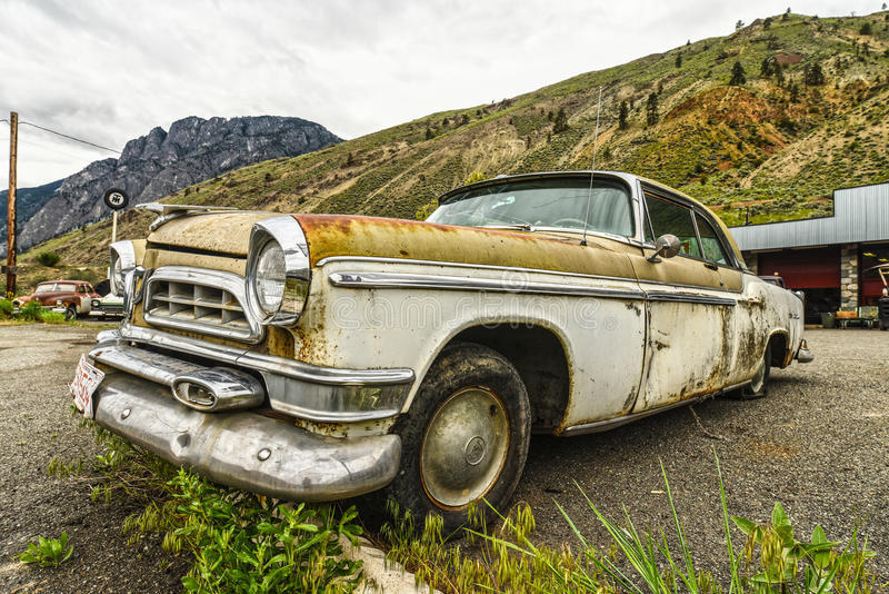 Spences Bridge, BC, old-timer car. SPENCES BRIDGE, CANADA - MAY, 24, 2017: Roadside vintage car at Vulture Garage, a store for vintage cars and antiques at royalty free stock photo