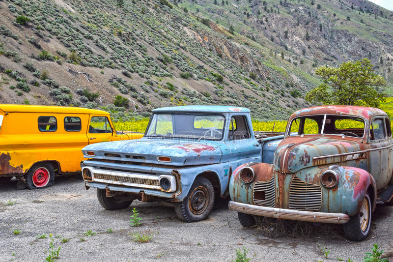 Spences Bridge, BC, old-timer cars. SPENCES BRIDGE, CANADA - MAY, 24, 2017: Roadside vintage car at Vulture Garage, a store for vintage cars and antiques at royalty free stock photo