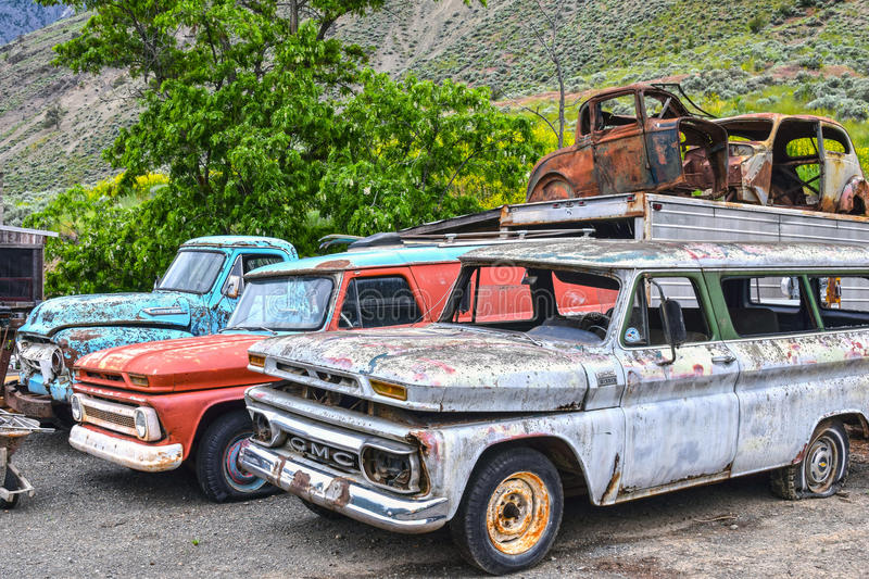 Spences Bridge, BC, old-timer cars. SPENCES BRIDGE, CANADA - MAY, 24, 2017: Roadside vintage car at Vulture Garage, a store for vintage cars and antiques at stock photos