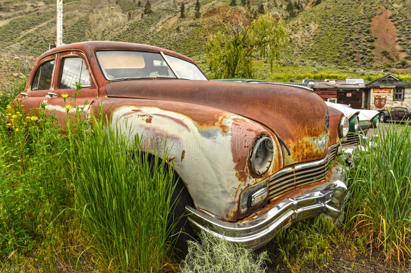 Spences Bridge, BC, oldtimer car. SPENCES BRIDGE, CANADA - MAY, 24, 2017: Roadside vintage car at Vulture Garage, a store for vintage cars and antiques at stock image