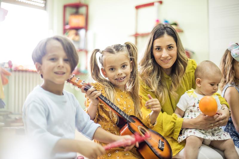 Spend every day playing music. Children in music school stock images
