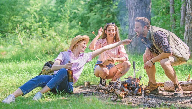 Spend great time on weekend. Take a break to have snack. Company friends eat food snack nature background. Hikers on. Picnic. Company hikers at picnic roasting stock photo