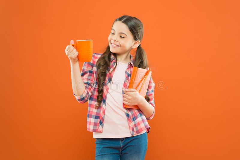 Spend nice time with favorite book. Girl hold cup of tea and book. Literature for kids. Enjoy spending time at home. Hot. Cocoa and good book perfect stock photos