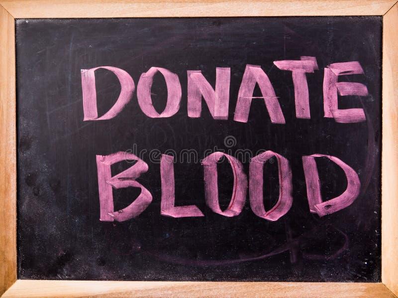 Spenden Sie Blutwort auf Tafel stockfotografie