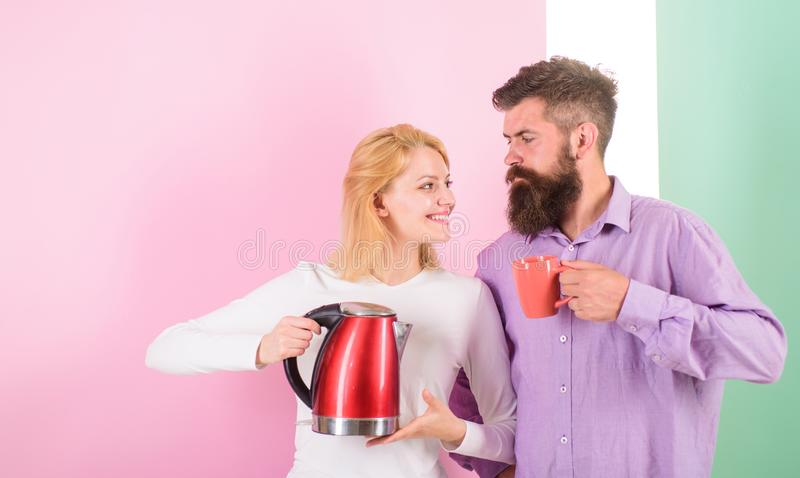 Spending good morning together. Couple prepare morning drink electric kettle device. Electric kettle boils water very. Quickly. Prepare favourite drink in royalty free stock photo