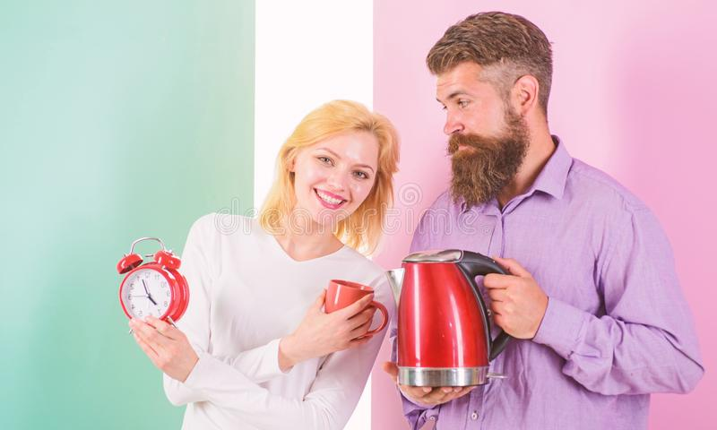 Spending good morning together. Electric kettle boils water very quickly. Prepare favourite drink in minutes. Modern. Devices make our life easier. Couple stock photos