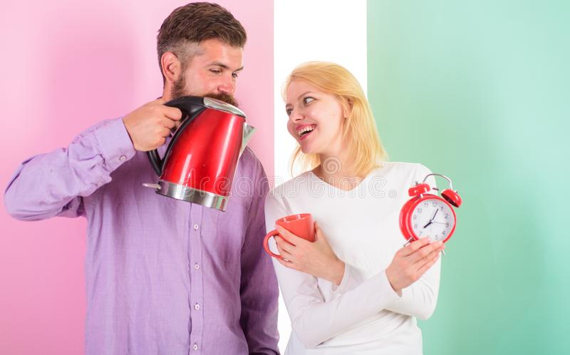 Spending good morning together. Prepare favourite drink in minutes. Modern devices make our life easier. Couple prepare. Morning drink electric kettle device stock image