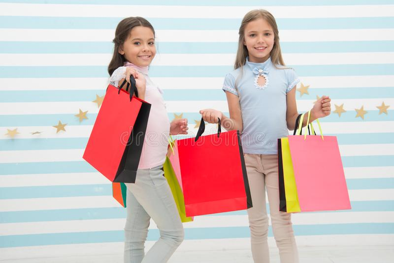 Spending great time together. Children satisfied shopping striped background. Obsessed with shopping and clothing malls royalty free stock image