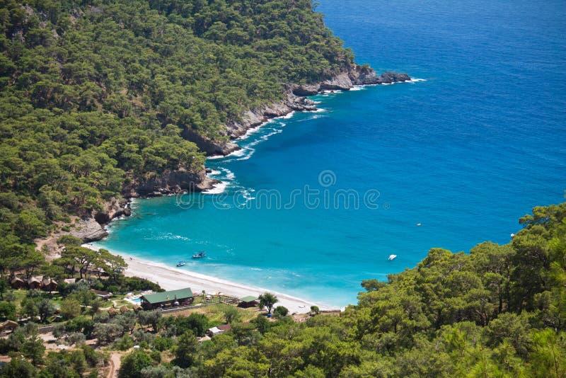 Spending summer holidays in beautiful kabak bay on aegean sea on turkish coastline, kabak, turkey. Visiting beautiful kabak bay on aegean sea on turkish royalty free stock images
