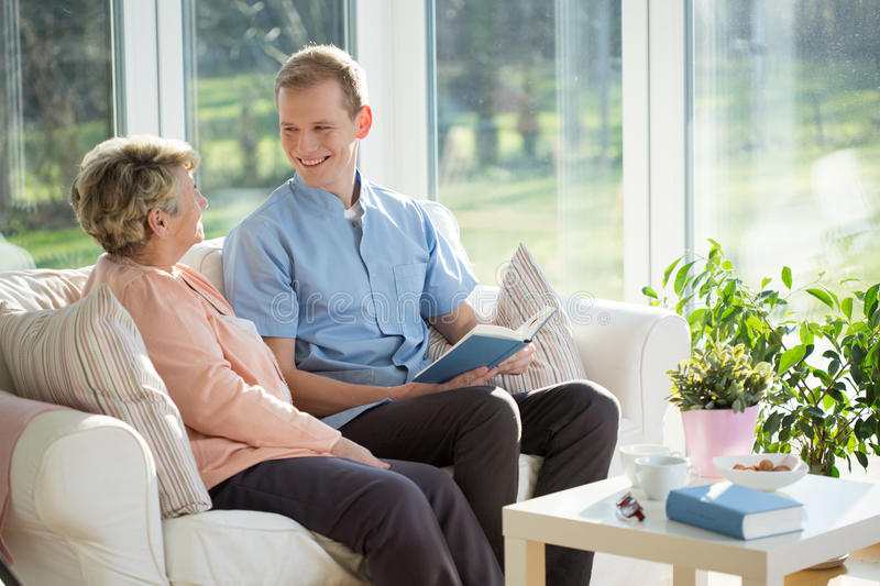 Spending time with elder woman stock photos