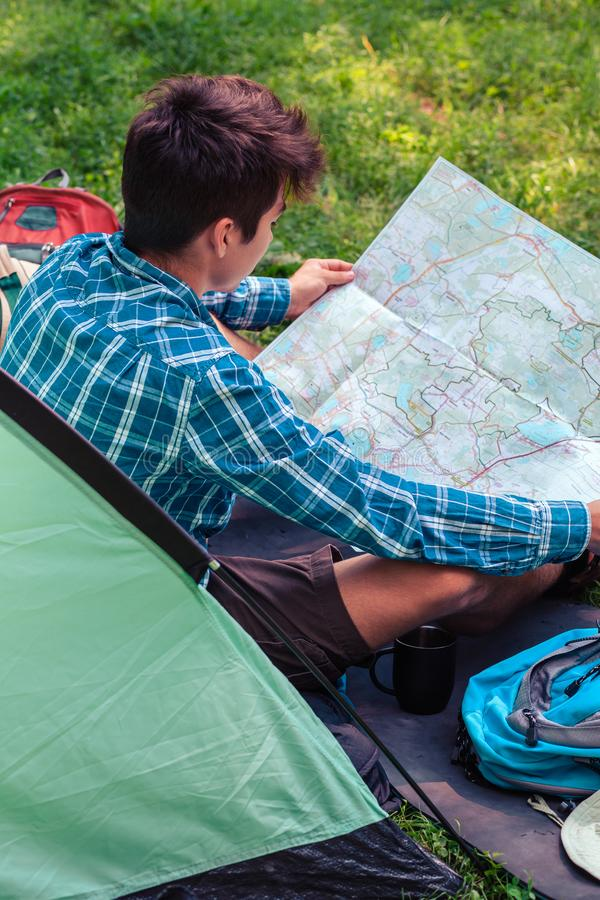 Spending a vacation on camping. Planning next trip stock photos