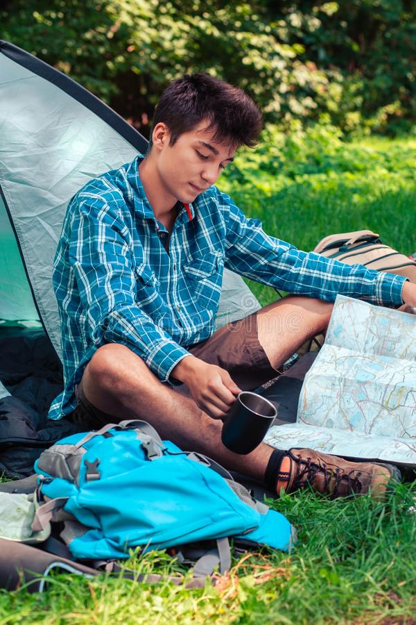 Spending a vacation on camping. Planning next trip stock photography