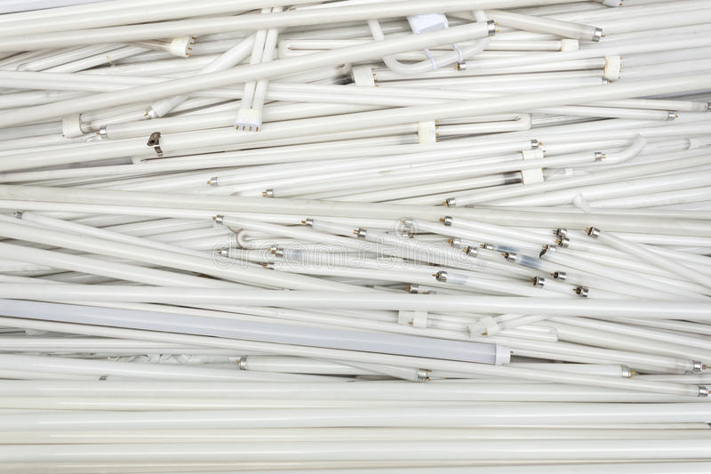 Spent old flourescent lamp tubes about to be recycled royalty free stock photos