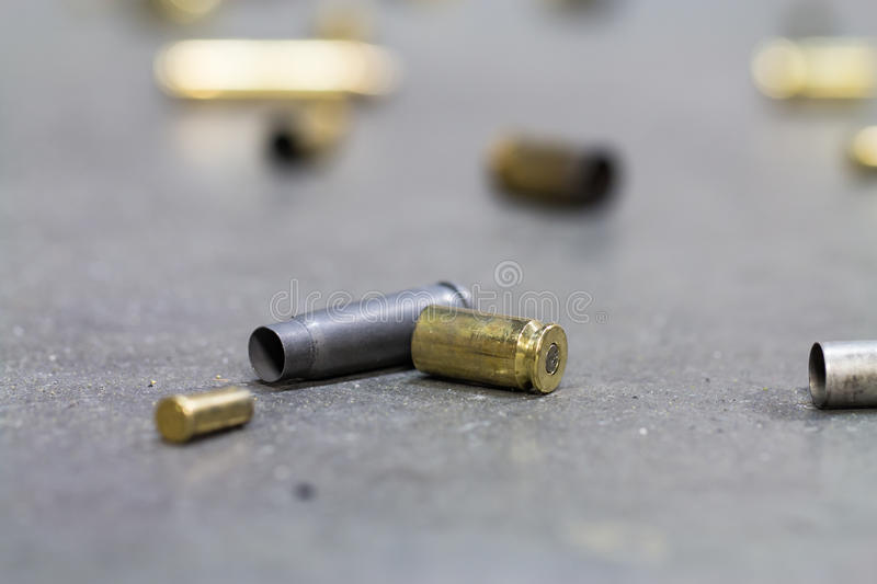Spent shell casings. Spent shell casings on cement background royalty free stock photos