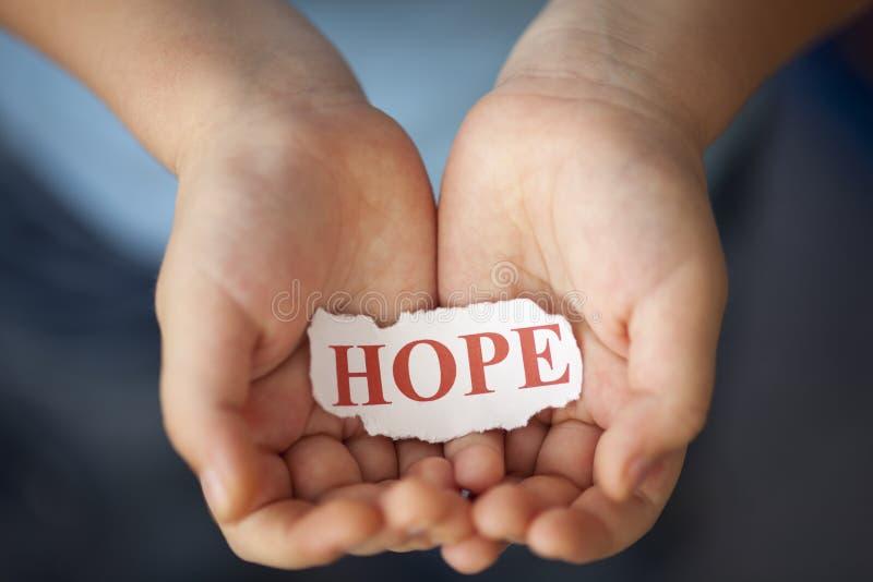 Speranza in mani del bambino fotografia stock