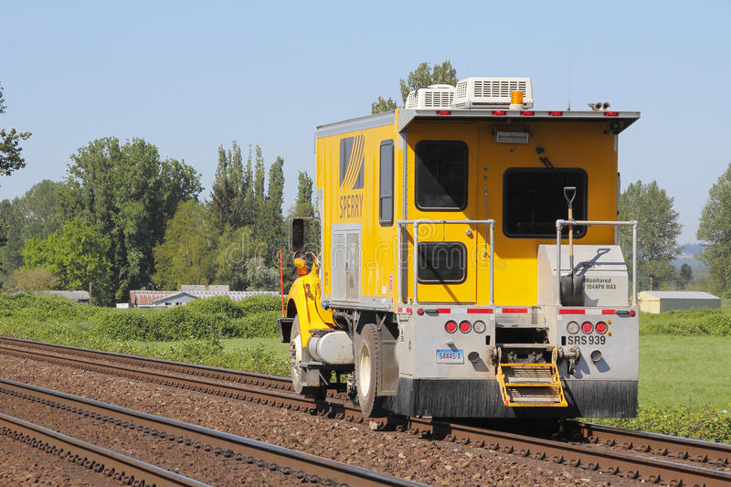 Sperry Rail Flaw Detector at Work. A state-of-the-art Sperry rail car, used to inspect problems with railway track is seen at work near Mission, BC, Canada royalty free stock photos