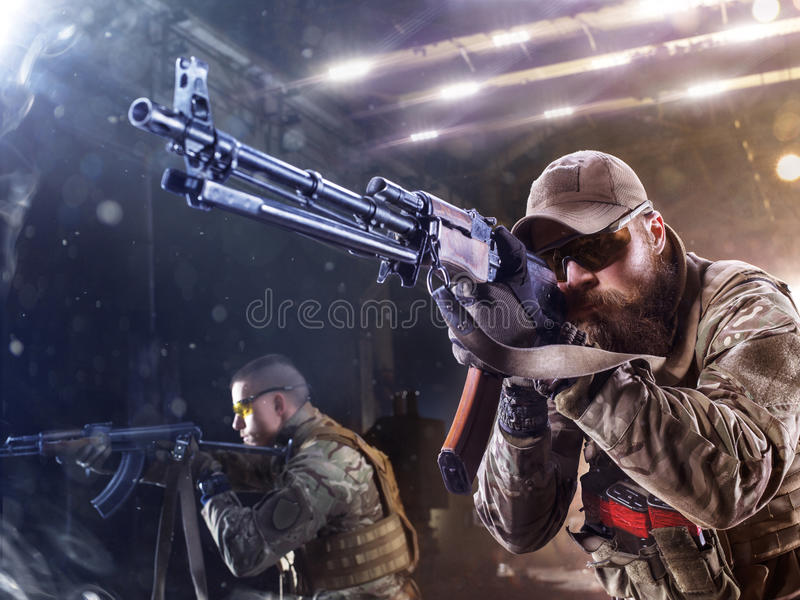 Spesial forces soldier attack the enemy. Spesial forces soldier shoot the enemy stock images