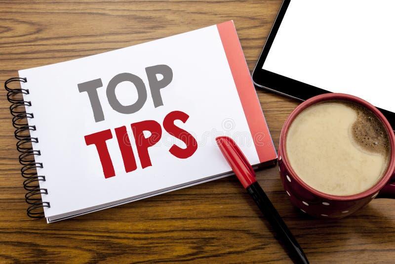 Spetsar för överkant för visning för handskriftmeddelandetext Affärsidé för sakkunnig spetsvägledning som är skriftlig på notepad arkivfoto