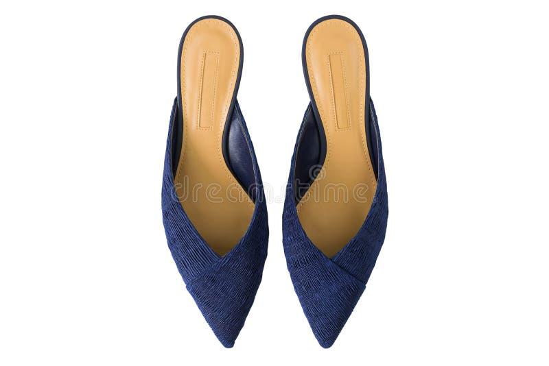 Spetsiga tåmulaskor i marinblått Snedsteg på plana skor som göras av tyg, bästa sikt arkivfoton