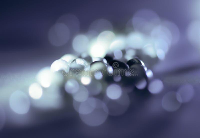 Sphères dans la lumière avec un fond désamorcé photo stock