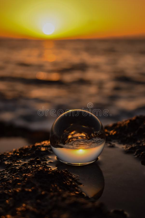 The sphere of infinite faces. Ball, sunset, orange royalty free stock image