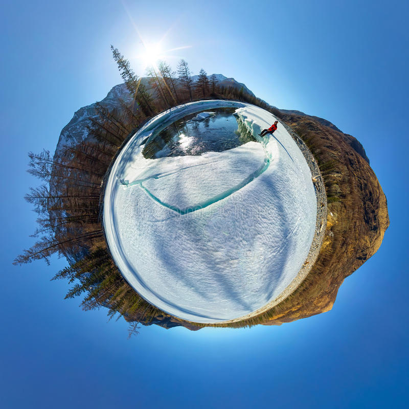 Spherical 360 180 panorama of a man on an ice melting river royalty free stock photos
