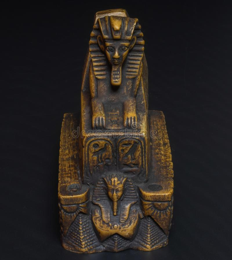sphinx figurine on a black background royalty free stock photo