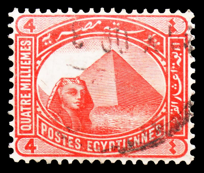 Sphinx in front of Cheops pyramid, serie, circa 1906. MOSCOW, RUSSIA - MARCH 23, 2019: Postage stamp printed in Egypt shows Sphinx in front of Cheops pyramid stock image