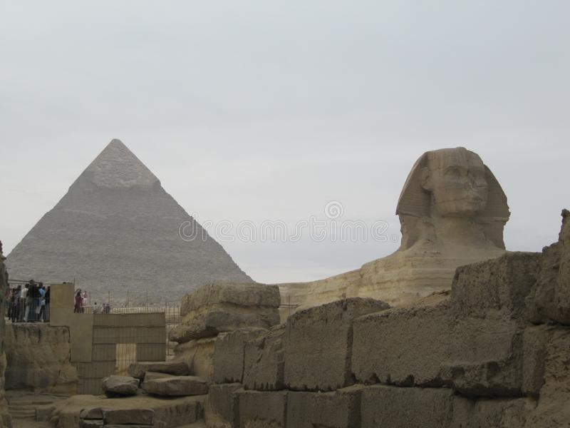 Sphinx in front of Pyramid in Cairo. Giza pyramid complex. Sphinx in front of Pyramid in Cairo, Egypt. Giza pyramid complex royalty free stock photos