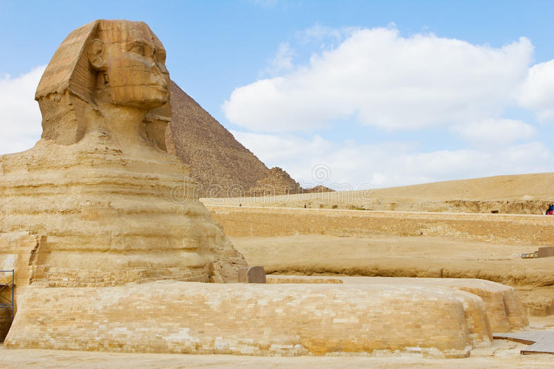 Sphinx in Giza. Sphinx at the backroudn of piramid royalty free stock photos