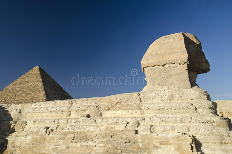 Sphinx and Great pyramid of Giza. Sphinx and Great pyramiid of Giza in Egypt. Gods of Egypt in stone and bricks royalty free stock images