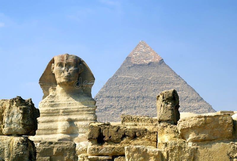 Sphinx and Pyramid. Of pharaoh Chephren, Giza, Egypt royalty free stock image