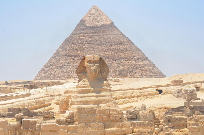 The Sphinx and Pyramid in Egypt. The wonderfull and misterious Sphinx guardian of King's valley in Gizah with the Cheope's pyramid on the back stock images