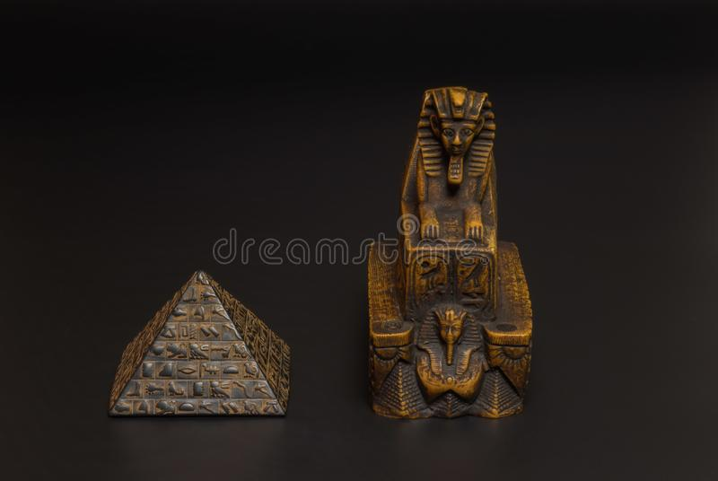 Sphinx and pyramid statuette royalty free stock images